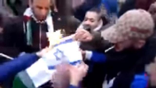An Israeli flag being burned in a Stuttgart demonstration