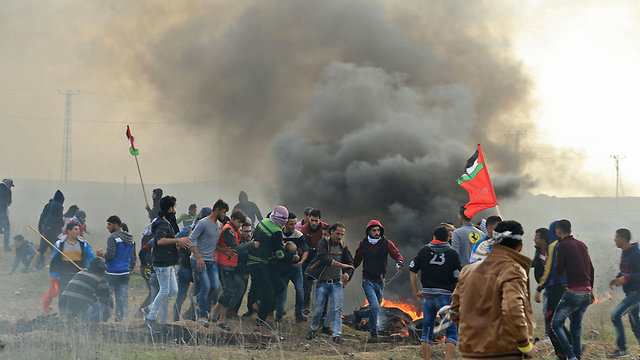 Palestinian protestors clashing with IDF over the weekend. 'For generations, the conflict has been understood as the prime irritant preventing peace and prosperity in the region' (Photo: AFP)