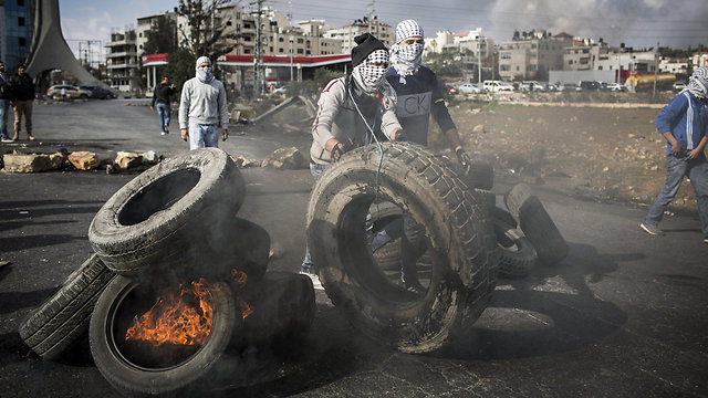 Palestinian protesters in Ramallah (Photo: Getty Images)