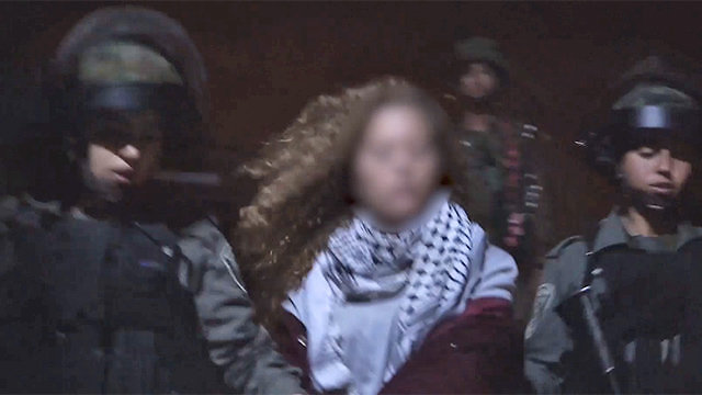 Tamimi being arrested by Border Policewomen (Photo: IDF Spokesperson's Unit)