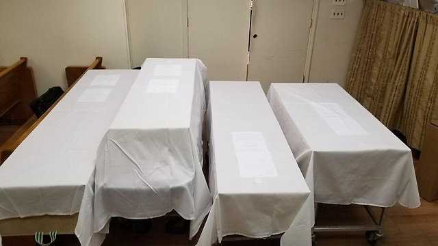The victims' four coffins (Photo: Yisrael Berger)