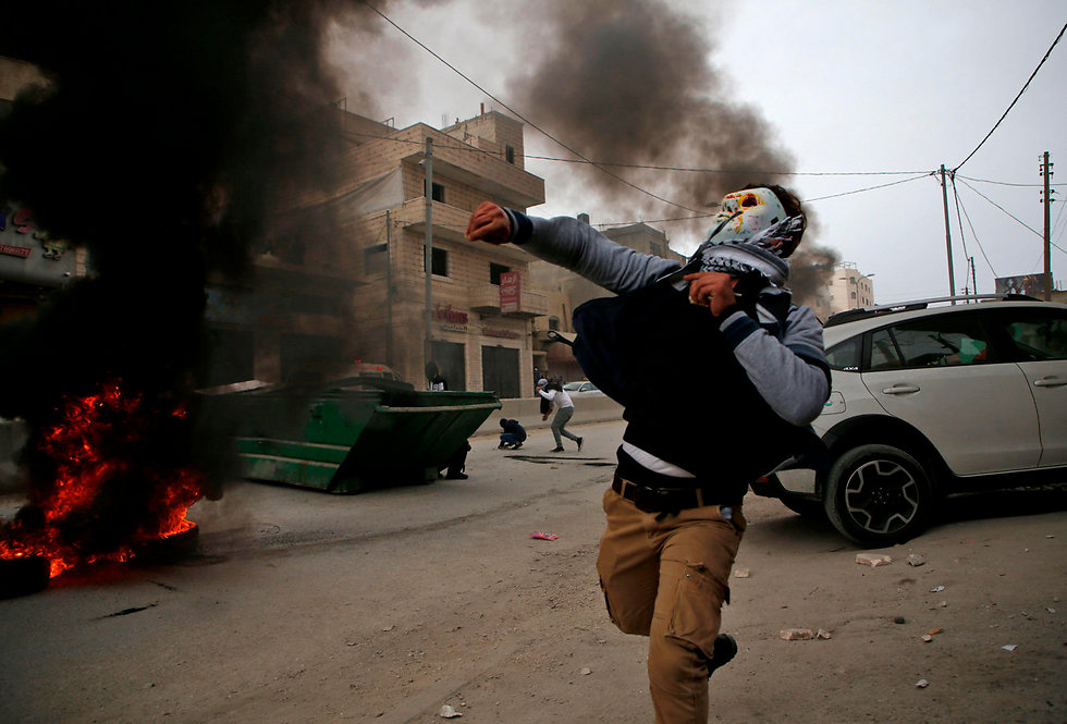 Palestinian rioting in Qalandiya in wake of Trump's Jerusalem declaration (Photo: AFP)