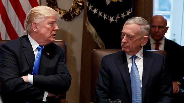 Mattis and Trump (Photo: AP)