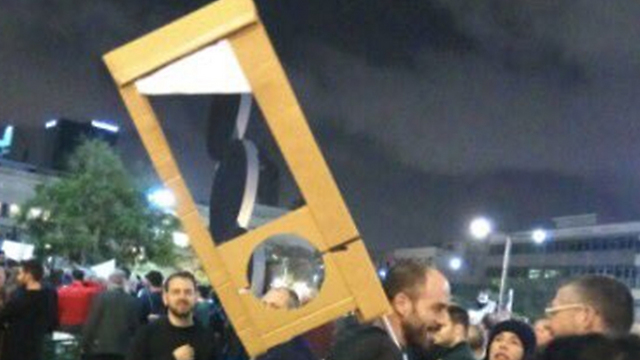 The controversial guillotine carried during Saturday night's protest