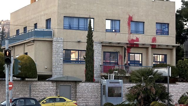 Embassy vandalized with red paint (Photo: EPA)