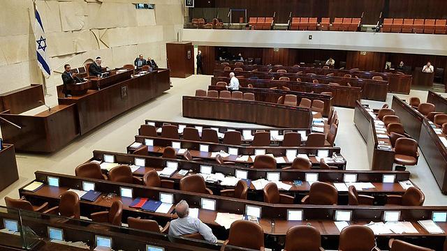 Zionist Union MK Yoel Hasson speaking to an almost empty plenum (Photo: Eli Mendelbaum)