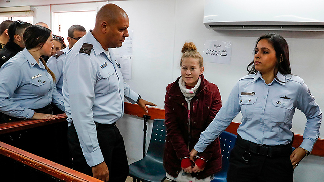 Tamimi can be a hero on social media, but in court she has to be judged for her actions (Photo: AFP)