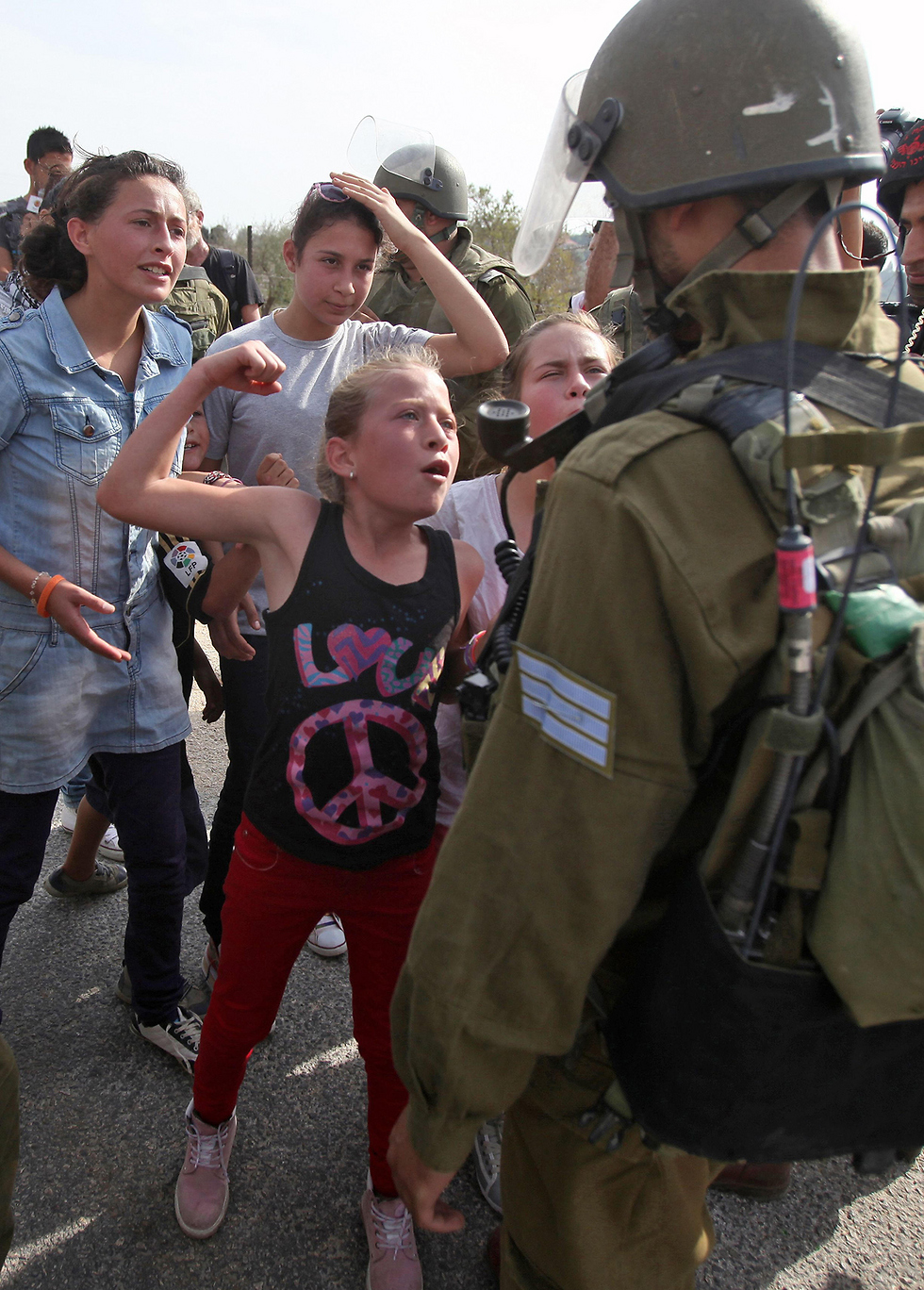Tamimi facing IDF soldiers in 2012 (Photo: AFP)