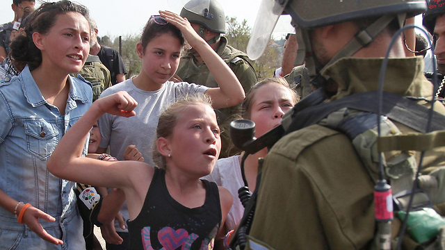 Tamimi family members provoking soldiers in 2012 (Photo: AFP)