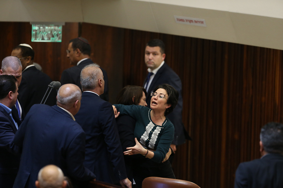MK Hanin Zoabi being removed from the Knesset (Photo: Amit Shabi)