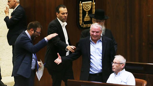 MKs Amsalem, Zohar and Hazan celebrate the new law, as MK Begin gazes forward  (Photo: Amit Shabi)