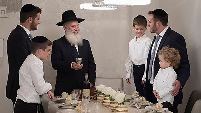 A Haredi family's Shabbat table--with no women present (Photo: Lapam)