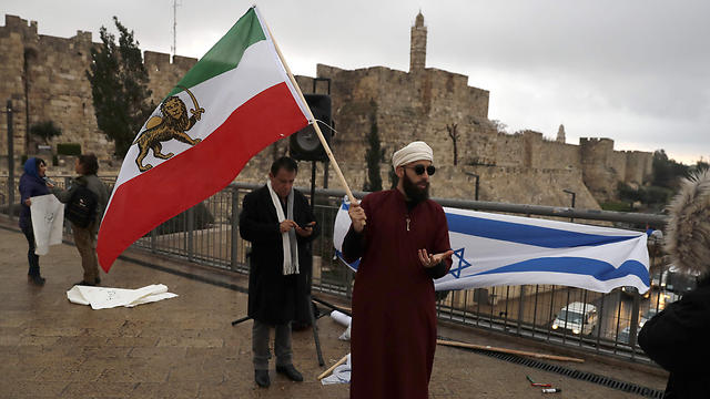 Iranian flag in Jerusalem (Photo: AFP)