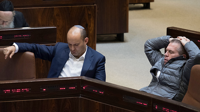 Education Minister Bennett and Public Security Minister Erdan during the late night vote (Photo: Yoav Dudkevitch)