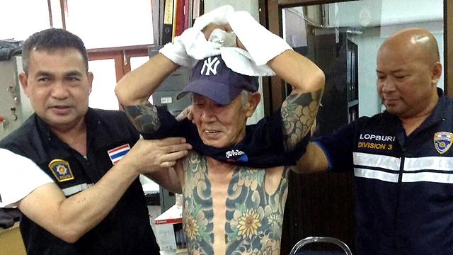 נעצר בתאילנד יוסגר ליפן בגין רצח חבר כנופיה יריבה. שיראיי וגופו המקועקע (צילום: EPA) (צילום: EPA)