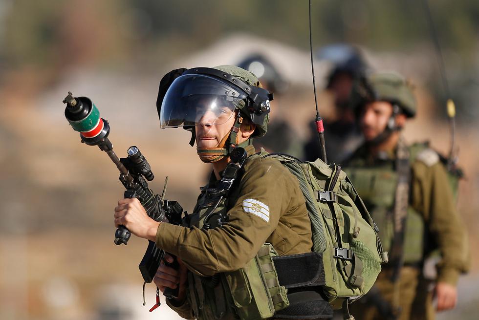 """כוחות צה""""ל במקום האירוע (צילום: AP)"""
