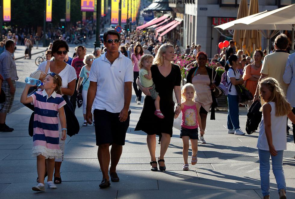 """ברחובות אוסלו. מי רוצה לעבור לארה""""ב? (צילום: gettyimages) (צילום: gettyimages)"""