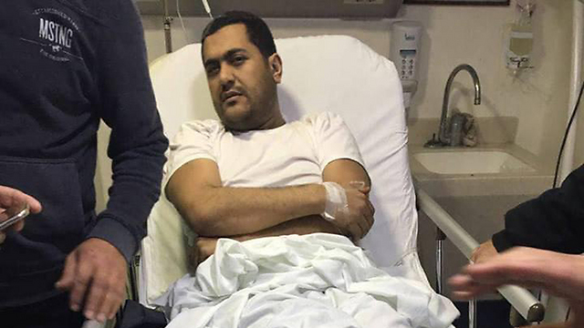 Mohamed Hamdan in the hospital following the attempt on his life