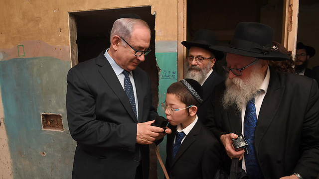 Netanyahu with the son of the couple who was murdered in the 2008 Mumbai attack on Chabad house. (Photo: GPO)