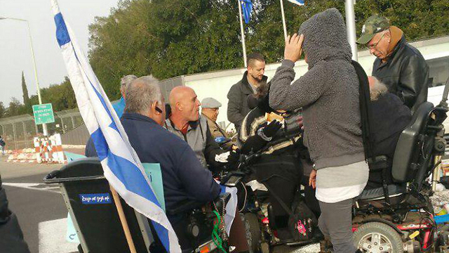 Disabled protesters decried the law's passage (Photo: Ofer Sofer)
