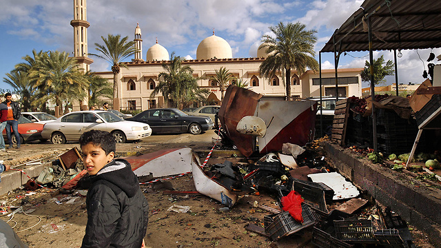 The aftermath of the double car bombing in Benghazi (Photo: AP)