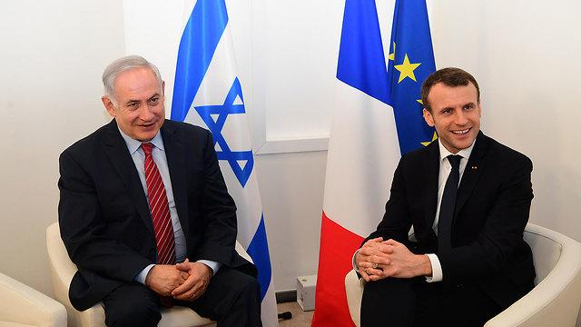 Macron with PM Netanyahu (Photo: Amos Ben-Gershom/GPO)