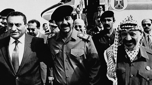 Arafat, right, with Saddam Hussein and Hosni Mubarak in Baghdad, 1988 (Photo: AP)