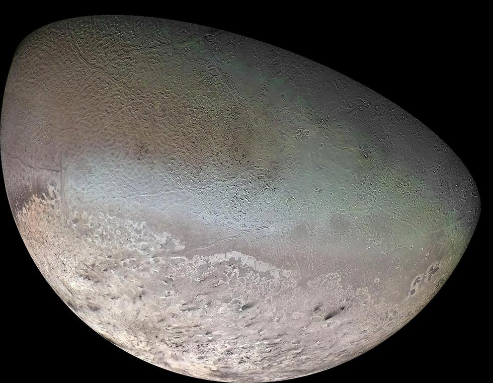 """הירח טריטון (צילום: נאס""""א) (צילום: נאס"""