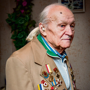 Zaslavsky with his long hair and medal-laden jacket