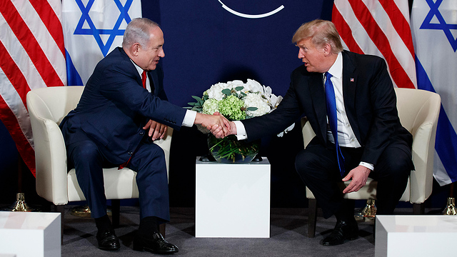 PM Netanyahu and President Trump in Davos (Photo: AP)