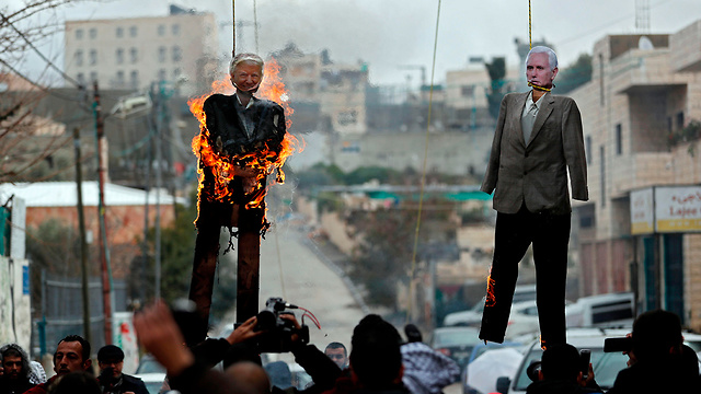 Hanging effigies of Trump and Pence in Aida (Photo: AFP)