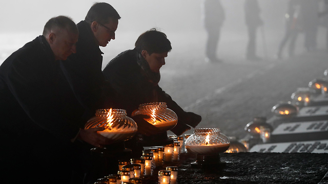 Visitors at the Auschwitz Death Camp on International Holocaust Remembrance Day (Photo: Reuters)