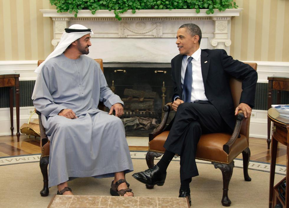 """עם נשיא ארה""""ב לשעבר ברק אובמה (צילום: AP)"""