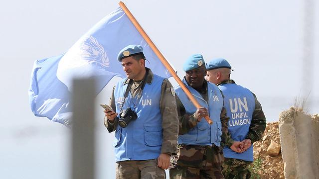 """אנשי יוניפי""""ל בגבול ישראל-לבנון (צילום: AFP)"""
