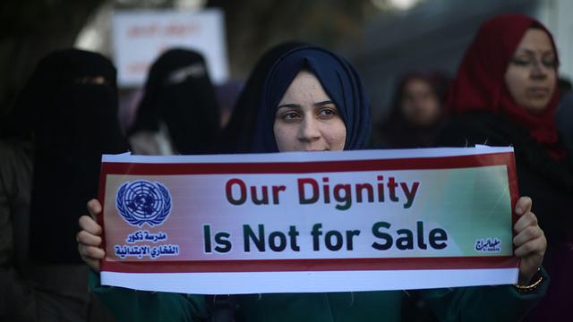 """הפגנות נגד הקיצוץ בכספי אונר""""א בתחילת השנה  (צילום: AFP) (צילום: AFP)"""