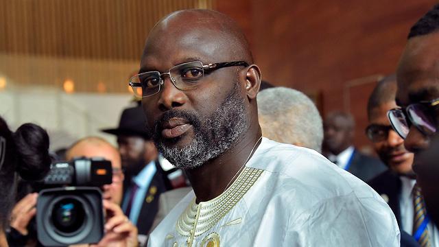 """""""מדינה שבורה"""". נשיא ליבריה ג'ורג' וואה (צילום: AFP) (צילום: AFP)"""