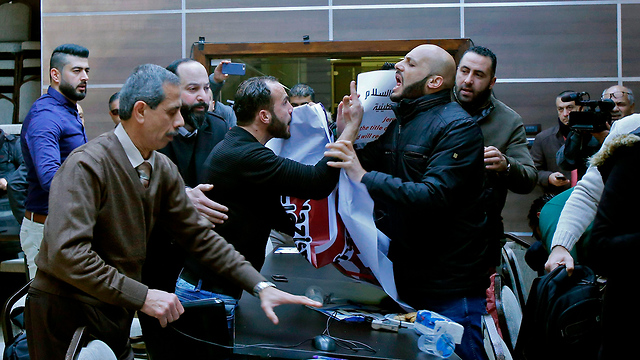 Protesters disrupting seminar in Bethlehem (Photo: AFP)