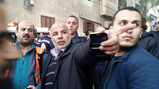 Commander of the Hamas security forces Abu Naim overseeing search & rescue efforts
