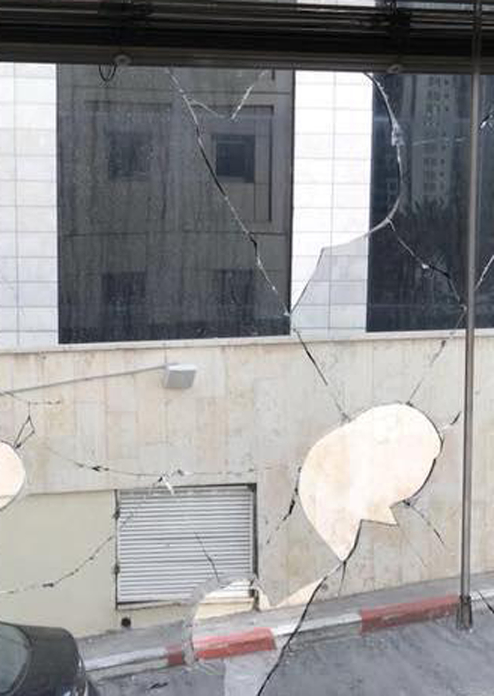 Damage caused from stones thrown at Ashdod municipality building