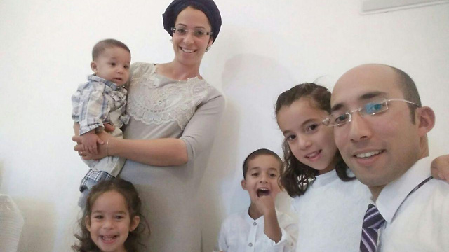 Terror victim Itamar Ben-Gal (R) and his family. If building isn't carried out anyway, it should be carried out in the name of blood spilled