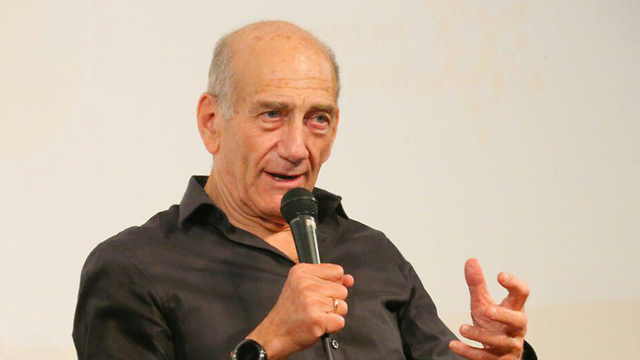 Former PM Olmert wished PM Netanyahu a speedy exit from office (Photo: Motti Kimchi)