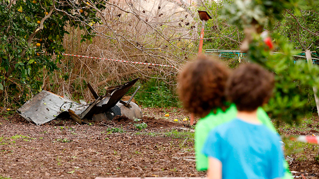 Part of Syrian missile in family yard (Photo: AFP)