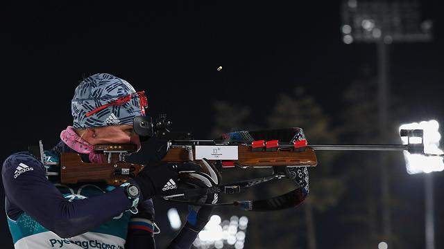 קוזמינה בתחרות המרדף. החלה במקום ה-13 וסיימה עם מדליה (צילום: AFP) (צילום: AFP)