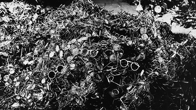 Pile of glasses of Holocaust victims in Auschwitz