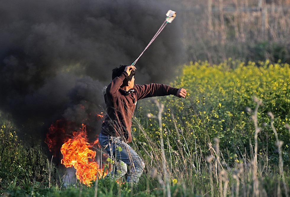 A young Palestinian near the Gaza border fence, Saturday  (Photo: EPA)