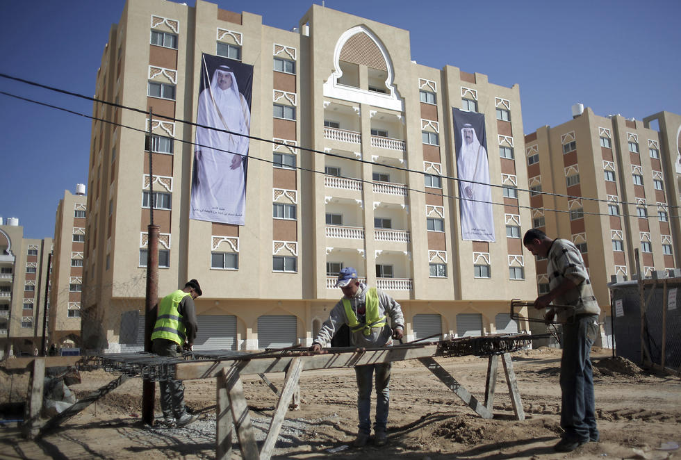 Palestinians work at the Qatari-funded Hamad City housing complex in Khan Younis, Gaza