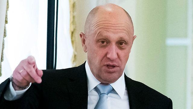 """פריגוז'ין עומד לדין בפרשת """"רוסיה-גייט"""" (צילום: AP) (צילום: AP)"""