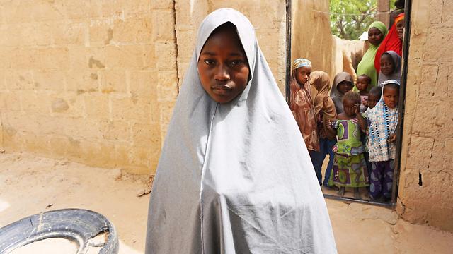 """ברחה במהלך התקיפה של """"בוקו חראם"""". חסנה מוחמד (צילום: AFP) (צילום: AFP)"""