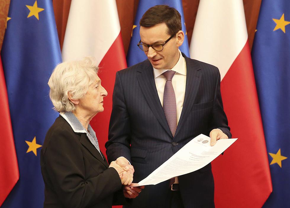 Stupnicka-Bando with Polish Prime Minister Mateusz Morawiecki  (Photo: AP)