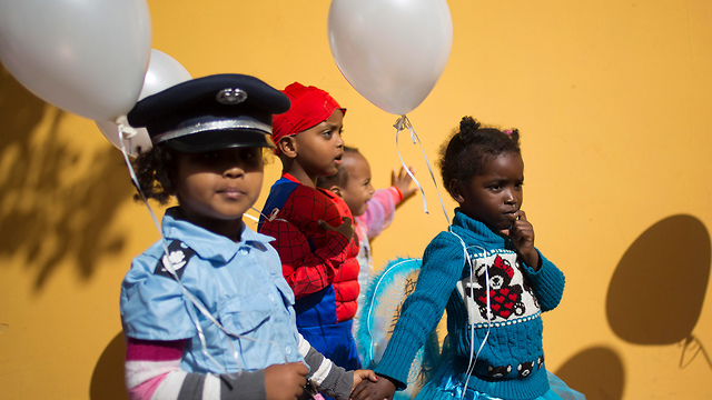 African migrants' children dress up for Purim in Israel (Photo: AP)